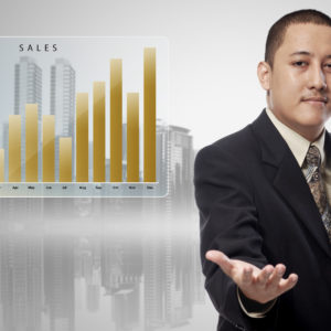 Asian businessman with chart sales offering to shake the hand in cityscape background