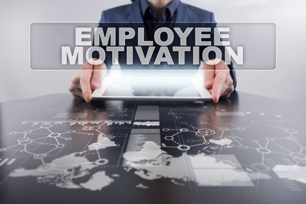 Businessman using tablet pc and selecting employee motivation.