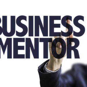 Business man pointing the text: Business Mentor