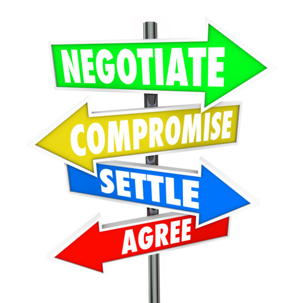 Negotiate, Compromise, Settle and Agree words on arrow signs to illustrate a diplomatic discussion to reach a mutually approved deal